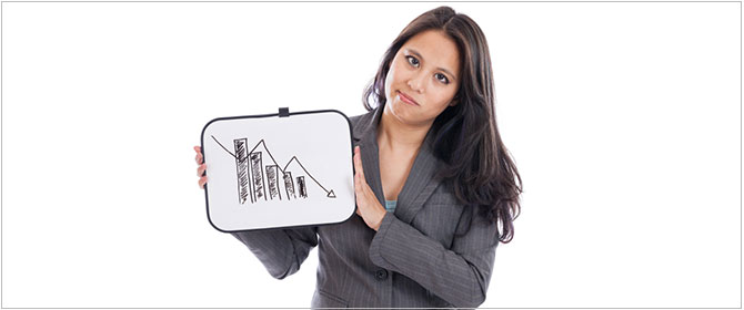 Woman holds bar chart showing downturn