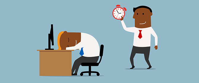 Man holds clock over colleague