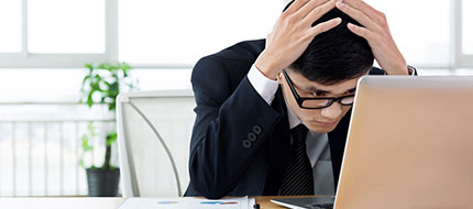 Stressed man at desk