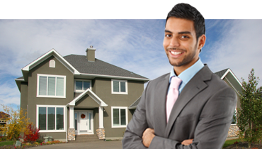 Male Realtor with House in background